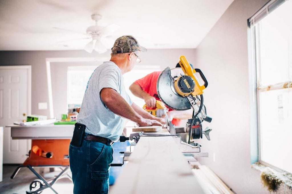 Two men remodeling a house